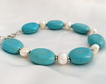 Elegant oval turquoise & freshwater pearl bracelet. Bright sky blue and white. Bold statement style