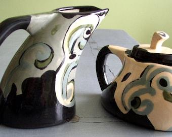 cream and sugar set ceramics and pottery serving dinnerware curved peach grey black swirls
