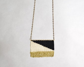 Hand woven pendant necklace cotton and bronze jewellry black white gold diagonal