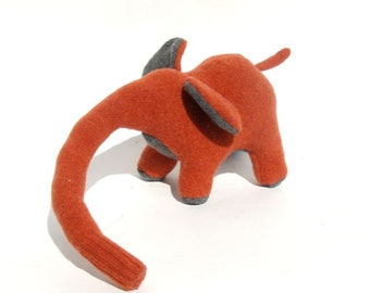 An Orange and Gray Lambswool Elephant