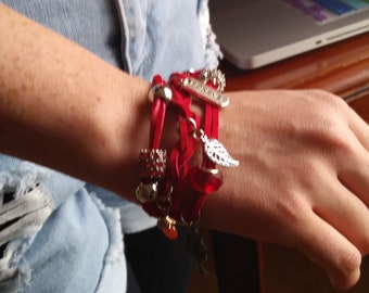 Red suede charm bracelet for every occasion.