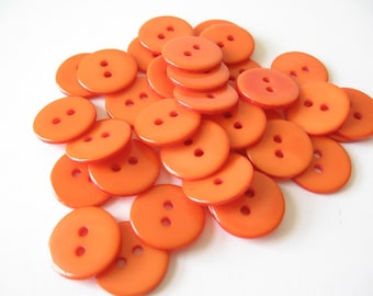 36 orange plastic buttons 2 hole 15mm