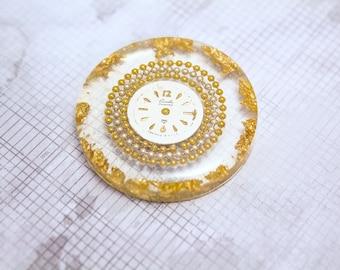 Resin art piece medallion in golden tones