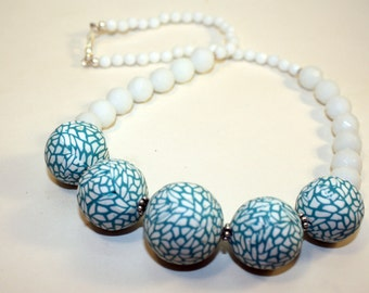 Lovely hollow bead necklace in polymer clay .
