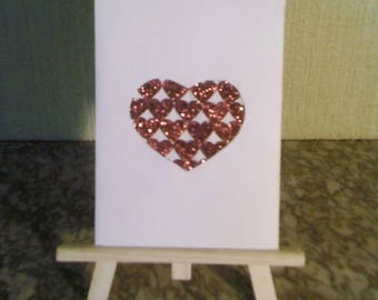 Card heart filled with glitter red hearts
