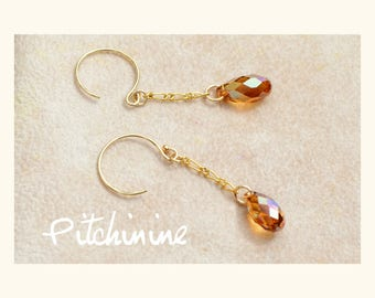 """Original and elegance to these earrings gold gold filled and its """"copper"""" Swarovski crystals"""
