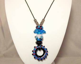Turquoise, purple, pink, blue and black necklace with artisan made glass beads on leather cord