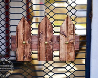 Dark wood stained picket fence hanging