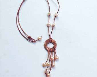 Pearl adorned leather neckalace with hammered copper