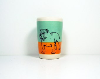 itty bitty cylinder in colour block of blue green & creamsicle, with a bulldog on it, made to order