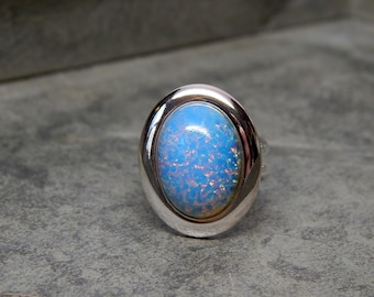 Silver light blue opal ring, glass opal ring, adjustable oval