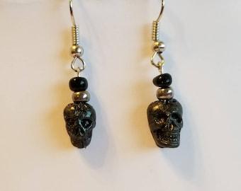 Black skull dangle earrings