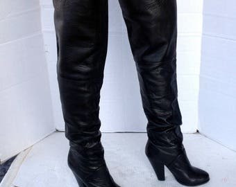 vintage black leather thigh high boots, high stack heels-round toe-stretch top- black textured leather-pull on  sz 37.5