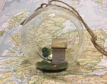 Glass bauble with a lovely pink house inside with button trees and flowers