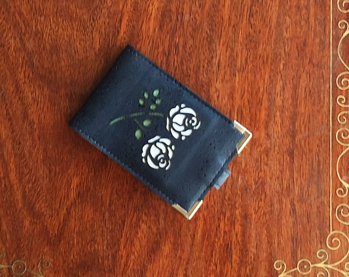 Mini card wallet made from vegan navy blue cork leather/fabric enhanced with a rose design backed in white and green cork leathers