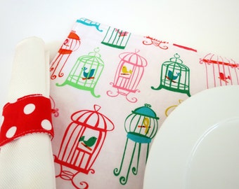 Pair of Reversible Placemats and Napkin Rings: Colorful Birdcages with Red Polka Dots