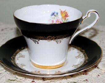 Vintage Royal Stafford Black,White & Floral Teacup and Saucer Gold Gild Trim Very Nice