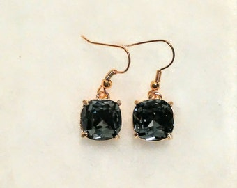 Gray grey faceted glass beads set in a beautiful gold setting earrings