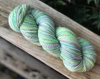 Handspun yarn, turquoise, yellow, pale pink, purple, mint green light blue tones, 100% merino wool, malabrigo wool, light sport weight