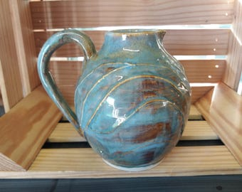 Medium blue-brown pitcher with embossing