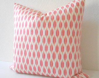Coral pink and orange ikat dots decorative pillow cover
