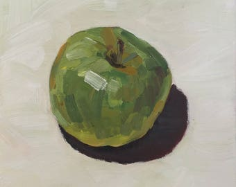 Self-sufficiency of an apple. Original oil painting on canvas, 15x15 cm, green apple on perl white tissue
