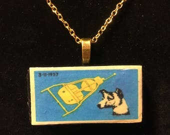 Soviet space dog Laika, sputnik Domino pendant necklace - vintage matchbox label