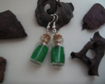 single earring with silver and green vial with sand