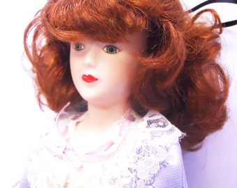 Lovely vintage Porcelain doll with elegant dress china doll with painted face and beautiful hair
