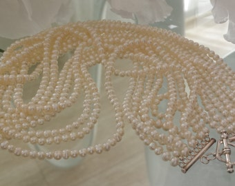 8 strand White Pearl Necklace
