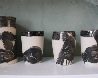Goblets made by hand for tea, coffee and drinks. Stoneware smooth glaze and black enamel silhouette black design engraved.