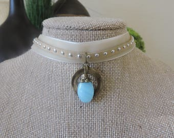 """5/8"""" Cream color velvet choker with attached overlay silver stud band with drop blue stone pendant with antique bronze accent"""