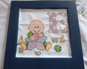 Wood frame with alphabet E embroidered baby