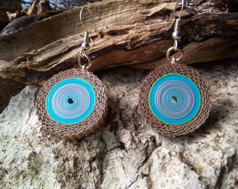 An unusual jewelry: Earrings made of cardboard and paper