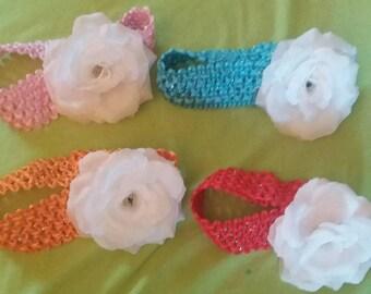 headband with white silk rose embellishment