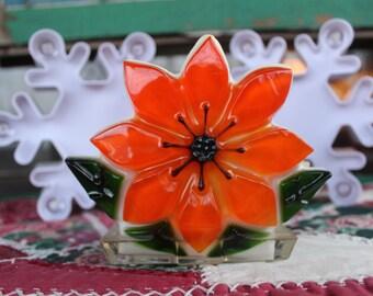 New Trends Resin Poinsettia Napkin Holder