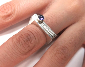 3 Sterling silver stacking rings with 1 amethyst and square edges