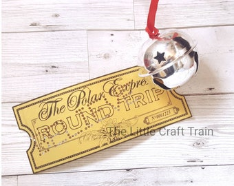 The Polar express themed golden ticket punched with 'believe ' / believe / polar express / golden ticket / ticket to ride