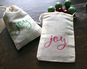 Christmas gift bags, set of 10. JOY script in red and green.  Great gift card holder. Hand stamped muslin bags, favor bags.