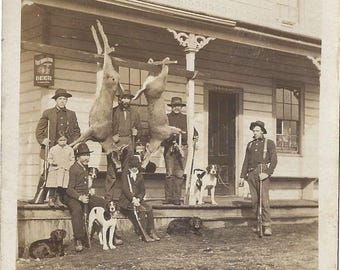 Antique RPPC ~ Hunting Deer Dogs Rifles Cowboys & Port Townsend Beer sign