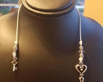 Hand made thong bookmark, featuring crystals, and sver tone skeleton key charm. For 10 inch book or smaller