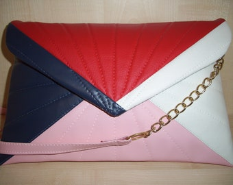 Over sized red, baby pink navy blue and white faux leather quilted clutch bag