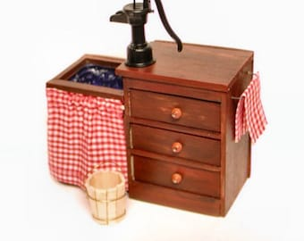 Colonial dark pine sink with water pump, wooden cooper bucket, 3 drawers, and 2 towels.  Dollhouse 1:12 inch scale.  Handmade in the USA.
