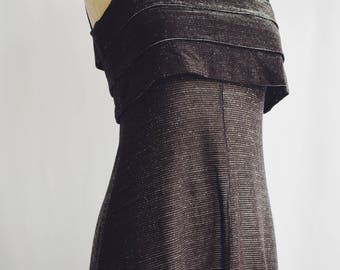 Vintage long black party dress with silvery glitters.