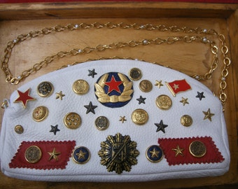 SALE- Ship shape mate...., White leather covered in Naval buttons and military pins.