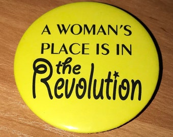 A woman's place is in the revolution badge