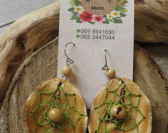 Leaf earrings surrounds dream catcher and Acai seed.