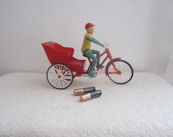 Vintage battery operated tricycle rider toy electric model