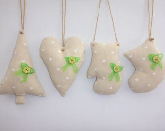 Rustic fabric Christmas tree ornaments in cream/white heart fabric. Pretty painted buttons, green ribbon and rustic twine for hanging.