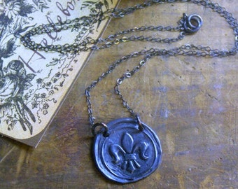 The Bayou Gloaming Wax Seal Necklace- Wax seal stamping cast in dark Oxidized Sterling Silver Fleur De Lis -. Hand forged by Chymiera